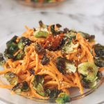 Butternut Squash Noodles with Harissa Cashew Cream and Crispy Brussels Sprout Chips