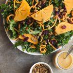 Massaged Kale Salad with Sweet Potato Noodles, Persimmon and a Smoky Orange Vinaigrette