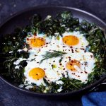 Skillet Baked Eggs and Greens with Herby Feta Yogurt Drizzle